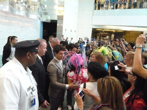 The Jonas Brothers greet fans in the Museum's Flag Hall