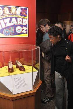 "Visitor views the ruby slippers from ""The Wizard of Oz"" on exhibit"