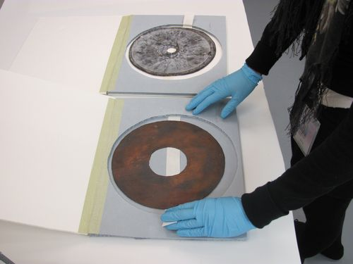 The discs in the collection were made using a variety of metals, paper, wax, and foil. Photo by Christine Klepper.
