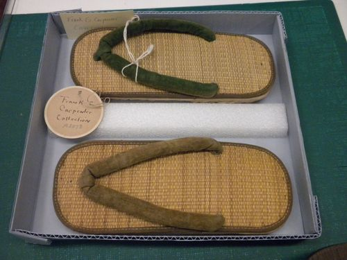 Japanese sandals from the Frank G. Carpenter Collection. This shows an example of rehousing using a custom-made box with foam divider.