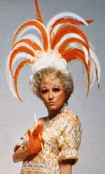 "Phyllis Diller, wooden cigarette, ""When I first got into this business I thought a punch line was organized drinking."""