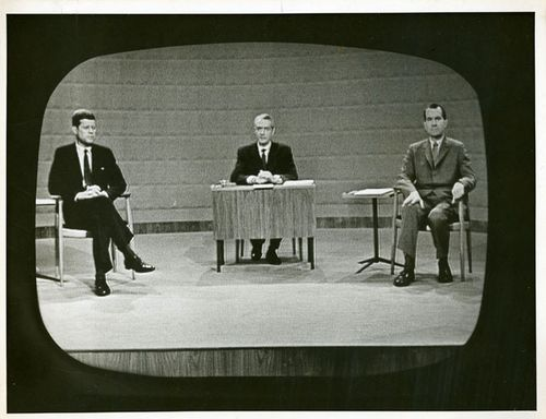The photograph of John F. Kennedy and Richard M. Nixon is from the debate held in Chicago on September 26, 1960, at the CBS studio. This was the first Presidential debate in history and it was televised, attracting 60% of American households with televisions.