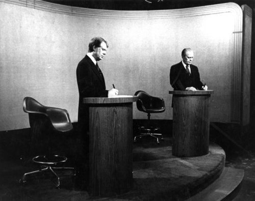 This photograph of then Governor Jimmy Carter and President Gerald Ford was from the 1976 debates. These were the first presidential debates since 1960 and they were sponsored by the League of Women Voters. 1976 was the year of the Bicentennial and the sense of history was very much in the descriptions of the debates given by political commentators. About 53.5% of American households with televisions watched.