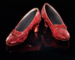 Our Ruby Slippers from The Wizard of Oz are temporarily reunited with the pinafore Dorothy Gale wore in the movie at the Victoria and Albert Museum.