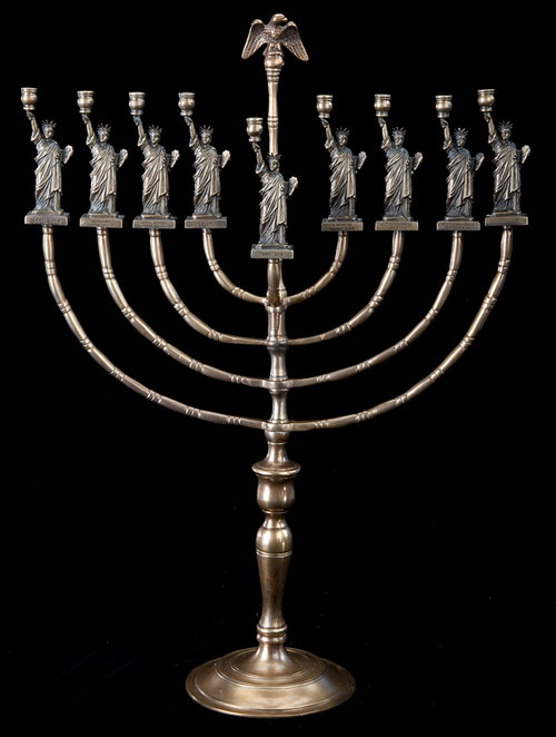 This menorah was made in 1986 by German immigrant Manfred Anson. And yes, those are small Statue of Liberty figures with words and dates representing events in Jewish history under them. You can explore this object in more detail with our Timelines Tell Stories guide for parents and children.