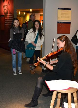 Playing Civil War fiddle tunes for visitors