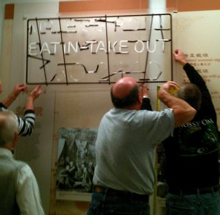 "Installation of the ""Sweet and Sour"" artifact wall"