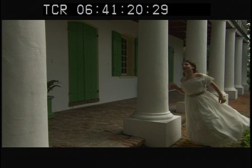 Young Loreta, played by Isabel Taysin Carter, runs through columns in her Cuban plantation home. Photo by Alex Vlacos.