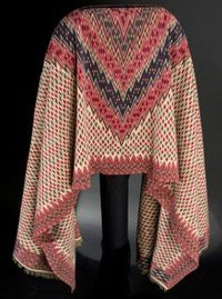 A serape is a long blanket like shawl, often brightly colored and fringed at the ends, worn especially by Mexican men