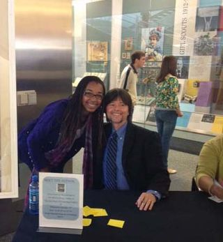"Ken Burns meets student Isabelle Maina and signs copies of his new book ""The Dust Bowl."""