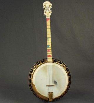 "This four-string banjo was made by the Gibson, Inc. in Kalamazoo, Michigan in 1927. It is a Mastertone TB-5 short neck tenor banjo and is stamped serial number 8693-1. This banjo was custom made for vaudevillian performer Vivian Chenoweth Hayes with jeweled accents on the peghead and inscribed with ""Vivian."" Vivian Hayes toured with her husband Ed Hayes and sister Frances as ""Ed Hayes and His Banjo Girls"" from 1927-1930."