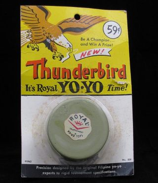 "This wooden ""Thunderbird"" model yo-yo was made by the Royal Tops Manufacturing Company in 1962."