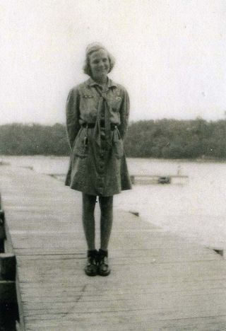 Joan Clark in her uniform at Four Winds in Manomet, Massachusetts , in 1943. This was her first overnight Girl Scout summer camp.