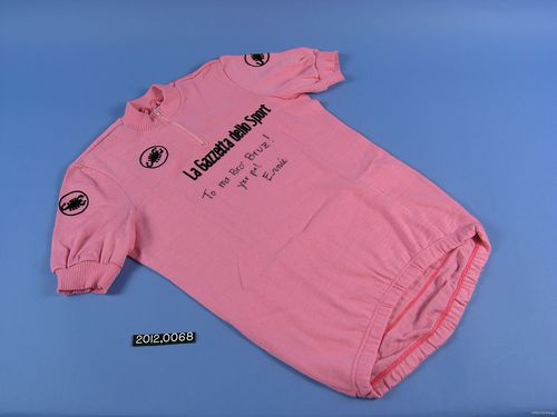 "Pink ""Maglia Rosa"" leader's jerseys awarded to Andy Hampsten during the 1988 Giro d'Italia. A Grand Tour is not won in a day, although winning an individual stage is an honor. At the end of each racing day, the rider with the fastest overall cumulative time is awarded a colored leader's jersey and wears it during the next stage. The rider wearing this jersey after the last stage—at the end of well over 2,000 miles in 20-plus days of racing—has the fastest cumulative time and wins the race."