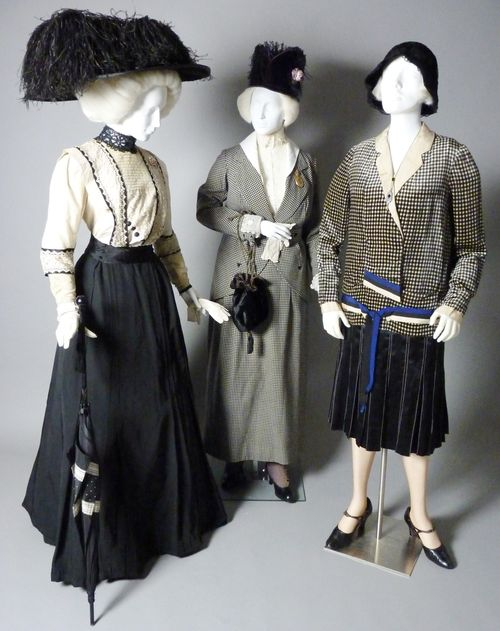 A trio of outfits shows the evolution from the last gasp of Edwardian bulk to the short, simple dress of the Twenties. Left, a two-piece dress of about 1907 (Daughters of the American Revolution Museum); center, a houndstooth suit of about 1914 (loan courtesy Shippensburg University Fashion Archives and Museum); right, black and white day dress, 1925 (Daughters of the American Revolution Museum).