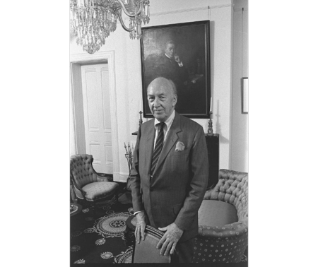 S. Dillon Ripley, eighth Smithsonian Secretary (1964-1984), standing in the Secretary's Parlor in the Smithsonian Institution Building in front of the portrait of Joseph Henry, first Secretary of the Smithsonian (1846-1878). Image from Smithsonian Institution Archives.