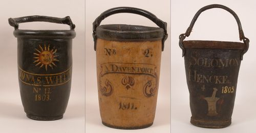 These painted leather buckets all date from the early 19th century. Though the owners of the first two are still unidentified, we do know that Solomon Henkel was doctor and druggist in New Market, Virginia, around the turn of the 19th century. A prominent figure in the early history of the town, he served as its first mayor and postmaster.