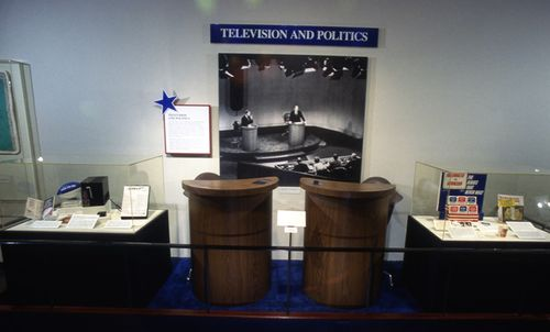 This photograph, taken from the 1996 exhibition We the People: Winning the Vote held at this museum, depicts the podiums and chairs used at the 1976 debates.