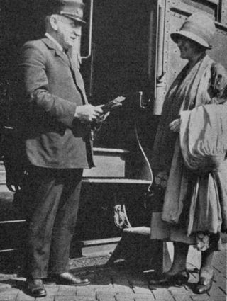 Pullman conductor John W. Zimmer greets a passenger in, Burlington, Iowa, 1925.