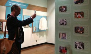 Kimball snaps a photo of his own photograph on exhibition in the museum.