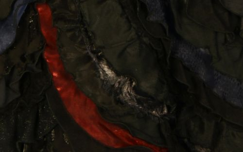 A close-up image reveals intricate details of the Elphaba dress designed by Susan Hilferty
