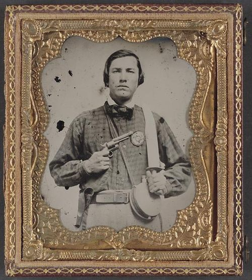 The patterned shirt worn by Private David C. Colbert (Company C, 46th Virginia Infantry) is similar to many that would have been sent from home. He also wears a secession badge on his chest. (Liljenquist Family Collection of Civil War Photographs, Library of Congress