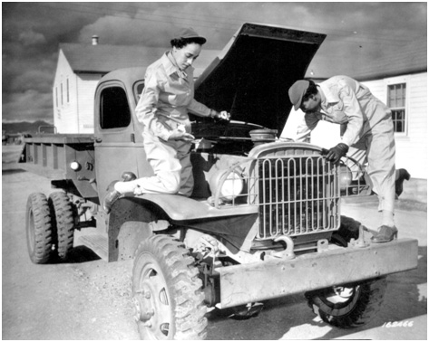 The U.S. Women's Army Corps (WAC) was largest of the women's branches in the American armed forces in WWII. In this photoof 8 December 1942, WACs Ruth Wade and Lucille Mayo, who had learned how to service trucks at the WAC training center, Fort Des Moines, Iowa, put their skills into practice at Fort Huachuca, Arizona. (Reproduction no. 111-SC-16246, National Archives and Records Administration, Washington, DC).