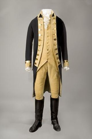 Blue wool coat, part of a suit of regimentals, worn by George Washington, with small clothes (breeches and waistcoat) dating from the revolutionary period.