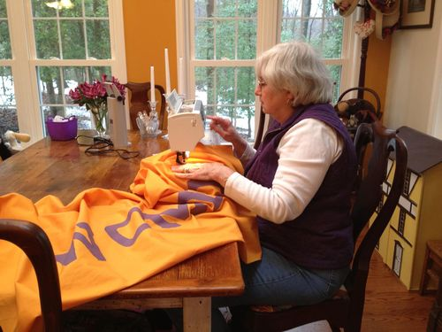 A member of the Annapolis Quilt Guild working on the reproduction banner. The original likely would have been produced using a sewing machine, too.