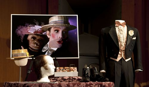 "The straw hat joins other elements of Grey's costume from the film, including a tuxedo of tailcoat, ruffled shirt, cummerbund, and pants. Bowers says that these pieces were created to look shabby, and are ""beautifully sort of tattered,"" which reflects the shady nature of Grey's character and the cabaret itself."