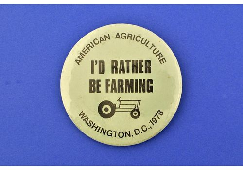 This pin is from the American Agriculture Movement of the late 1970s, worn in protest of the 1977 Farm Bill