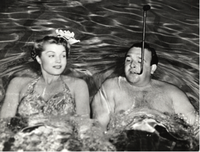 "Esther Williams and director George Sidney on the set of 1944 movie ""Bathing Beauty."" George Sidney Collection, Archives Center, National Museum of American History."