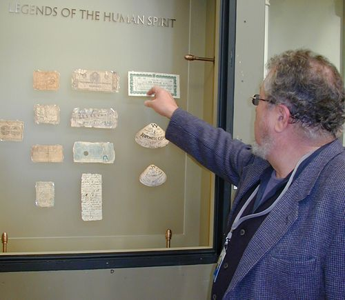 Curator Richard Doty installing an exhibition