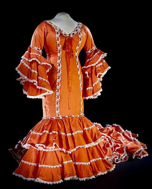 This is a Bata Cubana, or Cuban Rumba dress, donated to the Smithsonian by Celia Cruz in 1997.