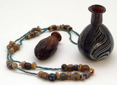 An Egypto-Roman string of beads, a Sidonian perfume bottle, and a Sidonian date flask. All are from the 1st century AD.