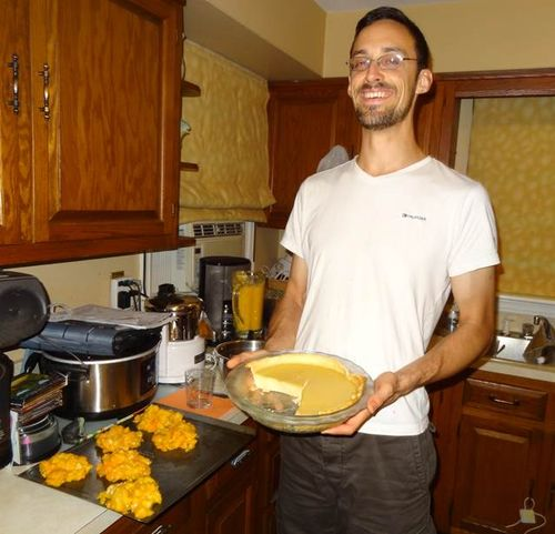 Lincoln Smith with a homemade Pawpaw custard pie, made from locally grown ingredients.