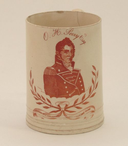 "Creamware mug transfer printed with red ink, 1815-1820. Included are the words of Perry's famous report, ""We have met the enemy and they are ours."""