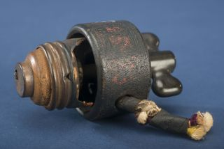 A small electrical switch with a burn mark that made curator Hal Wallace curious