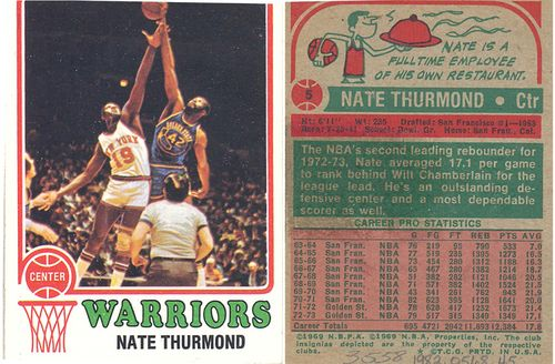 "Card of Barnett's teammate, Nate Thurmond. The reverse of the card lists Thurmond's height at a towering 6'11"" and shares that he was a full-time employee of his own restaurant"