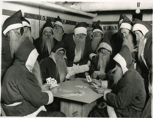 1920 Underwood and Underwood photograph of Santas playing cards