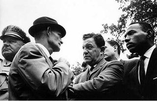 Despite a U.S. Supreme Court decision supporting his admission, Meredith was turned away three times. This photograph by Flip Schulke pictures the confrontation, on the third attempt, between Meredith, accompanied by Chief U.S. Marshall James McShane, and Mississippi's lieutenant governor, Paul Johnson (in fedora).