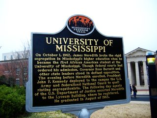 "Historical marker on the university campus. Photo by Flickr user ""ensign_beedrill"" via the creative commons license."