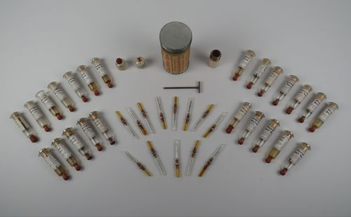 The museum's rabies vaccine kit, from the early 1920s, contains the following: three ampuls of rabies vaccine, doses one, two, and three; 26 syringes with physiological salt solution; 26 needles for the syringes; two metal piston rods and two metal finger rests for the syringes; one two-dram vial of tincture of iodine; two charts for recording cases; one letter of general instructions; two stamped return envelopes; one record-of-treatment blank; and one vial of sterile wires. The treatment at this time had been reduced to only 21 doses to be administered one a day for 21 days, and the Caloris vacuum bottle was replaced with a cardboard mailing tube.