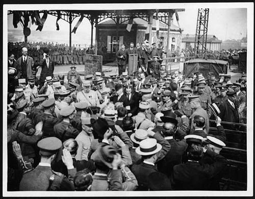 General Pershing, Commander-in-Chief of the American Expeditionary Force, arrives in France and is greeted by his uniformed men, ca. 1918. Pershing can be seen on the gangplank in the right side of the photo. Courtesy National Library of Scotland.