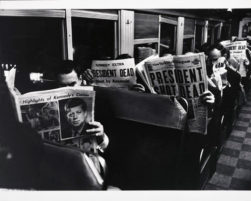 Photographer Carl Mydans of LIFE magazine snapped this photo of commuters on a train reading about the news of Kennedy's assassination