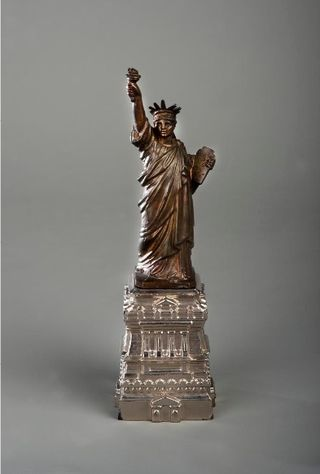 Souvenirs like this six-inch statuette, one of the first models of Liberty cast in the United States, were sold in the late 19th century to help raise funds to construct the pedestal for the Statue of Liberty. This model is currently on display in the museum's Souvenir Nation exhibition on display in the Smithsonian Castle.