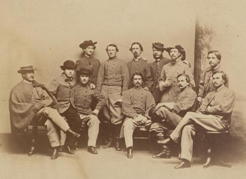 In this photograph, taken circa 1865, a clean-shaven Mosby stands in the center of a group of members of the 43 Battalion Virginia Cavalry. Albumen silver print photograph by David Bendann. National Portrait Gallery, Smithsonian Institution.