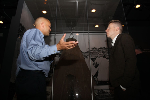 "Director of Experience and Program Design Christopher Wilson and Macklemore in the ""Changing America"" exhibition"