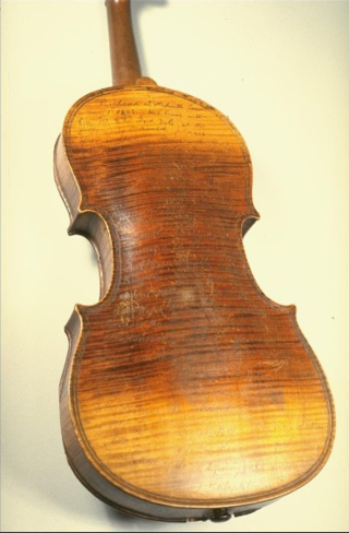 This violin was purchased by Solomon Conn in Nashville, Tennessee, on May 1, 1863. Conn carried the violin while serving with Company B, 87th Indiana Volunteers during the Civil War. Written on the back of the instrument are the names of places where the soldiers of the 87th were either on duty or engaging the enemy.
