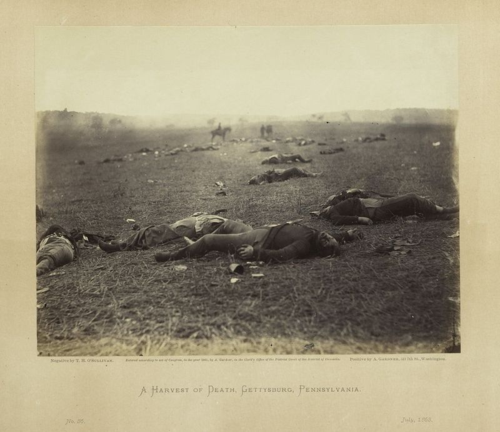 """A Harvest of Death, Gettysburg, Pennsylvania, July 1863"" is plate number 36 in Gardner's Sketchbook of the War. Timothy O'Sullivan made the photograph with a wet plate collodion negative. Alexander Gardner printed the albumen photograph, titled it, and provided an accompanying text."
